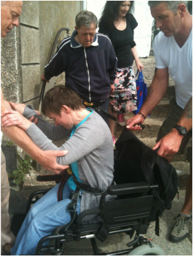 Kerry being assisted down steps in St Ives Harbour